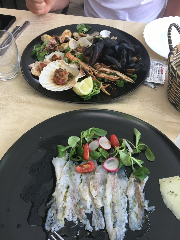 Carpaccio and mixed seafood grill